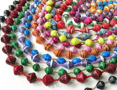 Paper Jewelry Part 3 of Traditional roll paper beads. The most popular way of making paper beads is by rolling a long triangle strip of paper. Paper Beads Tutorial, Make Paper Beads, Paper Bead Jewelry, How To Make Paper, How To Make Beads, Jewelry Crafts, Paper Beads Template, Beaded Jewellery, Silver Jewelry