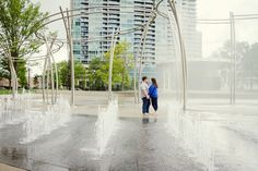 Engagement session in the middle of the fountains on the Scioto Mile in downtown Columbus