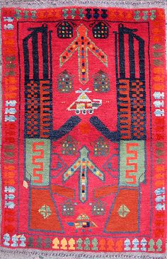 The red rugs shown here were woven by Turkmen men in refugee camps in Pakistan, and tended to feature weapons arrayed against a red backgrou...