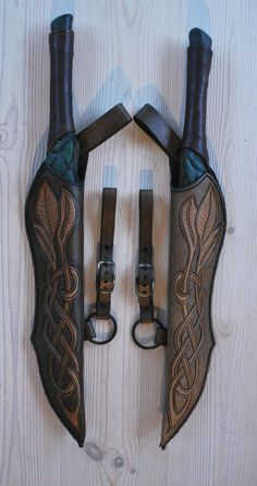 She'd use two daggers to fight with. Elven dagger-scabards Comm by ~Sharpener on deviantART Swords And Daggers, Knives And Swords, Larp, Elf Rogue, Hawke Dragon Age, Armadura Medieval, Leather Armor, Fantasy Weapons, Fantasy Dagger