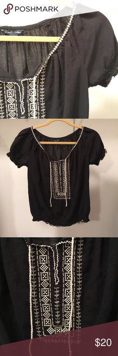 Black shirt Cute black shirt from American Eagle with a cream stitched pattern down the middle. Super cute shirt, easy to dress up or down. Gently worn as you can tell by the tassles (4th picture) but no stains or holes. *smoke free home* *price negotiable- make an offer!* American Eagle Outfitters Tops Blouses