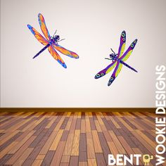 Dragonflies have been dancing around this world long before humans roamed the land. The oldest fossil specimens are 325 million years old. Ancient humans decorated their walls, pottery, and all manor of items with their beautiful likeness. Follow in that tradition and add some amazing color to your home, bedroom, or any wall with these full color dragonfly wall decals. This pack includes both dragonflies in the sample image.   Product Details - High Quality Solvent Printed Professional Wall…
