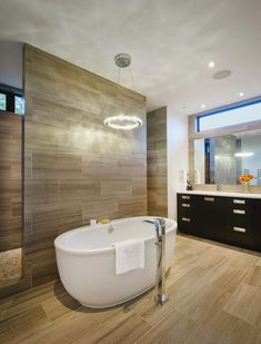 Bathroom using a modern bathroom bathtub design in it is a bathroom design that you may often see. Usually, this bathroom design not only uses a bathtub but als Modern Luxury Bathroom, Modern Bathtub, Modern Master Bathroom, Bathroom Design Luxury, Bathroom Spa, Bathroom Interior, Modern Room, Bathroom Ideas, Luxury Bathrooms