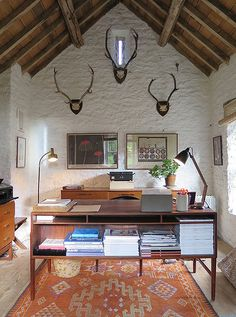 The stag antlers on the wall came from her husband's aunt, Anne Brooks, as did the metal box behind the desk.