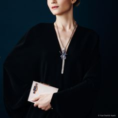 """Van Cleef & Arpels new """"Jewelry and Watches"""" catalog. Minaudière®  with secret watch, Van Cleef & Arpels collection, yellow gold, styptor and sapphires, 1934. Zip Noeud Saphir necklace, white gold, round and princess-cut diamonds, baguette-cut sapphires."""