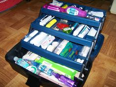 First aid kit in a tackle box. Includes list of items
