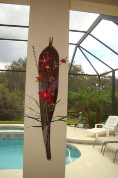 seed pod with silk flower arrangement.