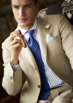 Summer linen tan suit with blue tie and striped dress shirt - ideal for summer events