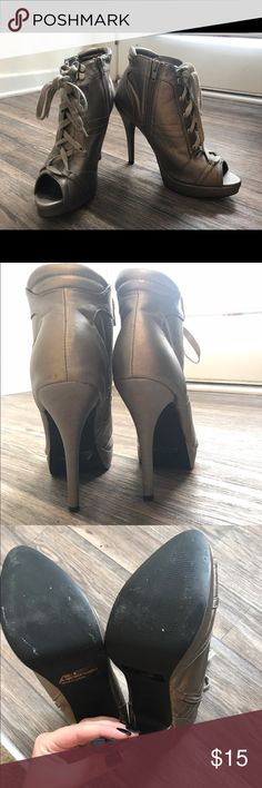 Lace Up Heels Silver heels in great condition, worn only a few times and it's only noticeable on the tread. JustFab Shoes Ankle Boots & Booties