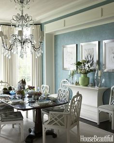 """""""Entertaining is what Palm Beach is all about,"""" says designer Gary McBournie. Everything white, including a sideboard from Lars Bolander and vintage Chinese Chippendale chairs, makes a crisp contrast to custom-glazed duck-egg-blue walls. Though new, the Dennis & Leen chandelier was found in a Palm Beach antiques shop: """"It was probably too large for someone's house. But here, it fills that void at the center of the room and gives it character."""""""