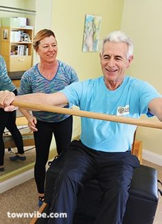 Black Rock Pilates owner Laura Pennock works with actor and Pilates devotee James Naughton to strengthen his arms and shoulders.