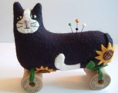 Ah, a Fun Sunflower Cat on Spools