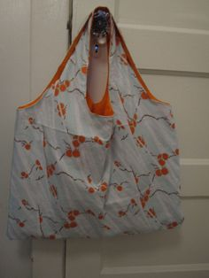 Blue and orange reversible grocery bag