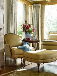 Hello sunshine! This Avignon Chair & Ottoman sure bring some happiness to this room. No matter if it's Winter or Summer, yellow will always be a joyful color.