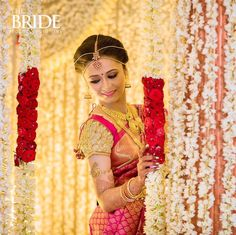 South Indian bride. Gold Indian bridal jewelry.Temple jewelry. Jhumkis. Red silk kanchipuram sari.Braid with fresh flowers. Tamil bride. Telugu bride. Kannada bride. Hindu bride. Malayalee bride.Kerala bride.South Indian wedding