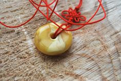 Genuine Baltic Amber Donut Pendant Red Cord by AmberBusinessGifts