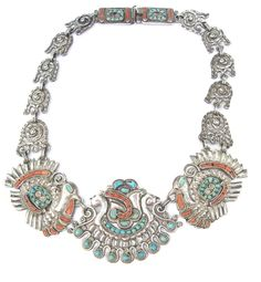 An incredible vintage Mexican silver necklace by Matilde Poulat, Mexico City, ca. 1940s/50s. A rare form is seen in this Matilde Poulat piece. The turkey and squash are celebrated in repousse form adorned generously with turquoise and coral. Articulated flower central element.