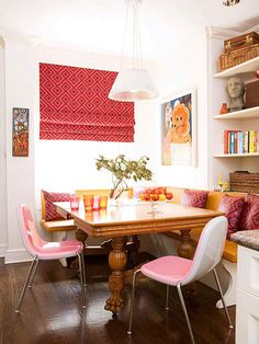 Bright Dining Employ pops of color to enliven petitie dining quarters. Hues of pink and orange bring vibrancy and energy to the space. A corner banquette saves space and makes the dining area much cozy. A bold print on the window shade and throw pillows and the shiny mod chairs bring a contemporary touch to the corner.