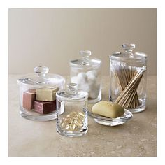 Crate  Barrel Glass Canisters for bathroom counters. Looks very stylish and prettier than a q tip box!!