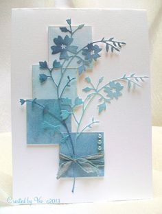 """By Viv. Die cut """"Bella Bouquet"""" (Memory Box) twice from blue or white cardstock. Sponge with chipped sapphire, broken china, and tumbled glass distress inks. Cut squares and sponge them in the same inks. Position squares on white card base so they are overlapping. Pop up the bottom two. Add die-cut flowers over the squares. Add ribbon and pearls."""