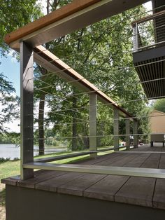 Cable rail for the rear deck at the Katonah Lake Shore Modern | Fivecat Studio Architecture and Construction | Architects serving Westchester County, NY