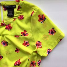 """Floral Peplum Top So bright and fun! Perfect with shorts or your fav skinnies!! Neon yellow accented with bright floral prints, worn once. Perfect condition! Elastic peplum waist, chest 19"""" shoulder to hem 24"""". Flowy fit. Tops Blouses"""