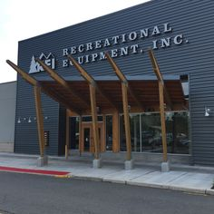 Striking Glulam Timber Entrance At REI | Wood Times Blog Sustainable Architecture, Amazing Architecture, Metal Cladding, New Shop, Places To See, Sustainability, Entrance, Pergola, Solar