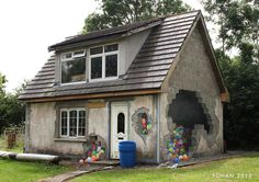 Clever mural painting on a cottage by artist Ciaran brennan