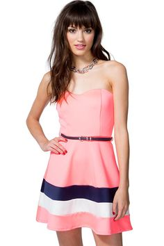 A flirty retro-inspired flare dress featuring a colorblocked skirt and a padded sweetheart bust. Strapless. Belt loops at the waist with a skinny leatherette belt. Finished short hem. Partially lined.