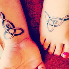 "Mother and son tattoos. Celtic knot meaning ""mother and child"""