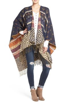 This intricate geo-patterned poncho with sparkling golden threads adds earthy style to a cozy on-trend look when paired with denim and booties.