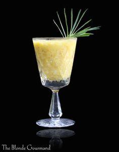 Banana Daiquiri -   3 ounces dark rum    1 ounce banana liquor (optional)    ½ ounce lime juice    1 tablespoon sugar    1 very ripe banana    1 cup ice