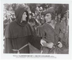 THE ADVENTURES OF ROBIN HOOD (1938): Warner Brothers, 1976 United Artist Reissue, B&W glossy publicity still, Robin Hood (Errol Flynn) and King Richard (Ian Hunter) disguised as a monk, 8 x 10 inches, Still No #3, NM condition, $12