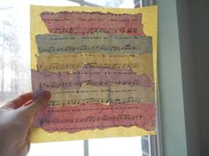 I thought of this myself! Just take some sheet music, tear it into strips and dip it in cups of water and a little paint mixed together, let it dry, then glue it down in order.
