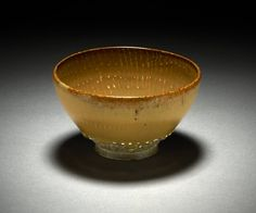 Teabowl. Made of stoneware with a thick iron oxide and white dot glaze design. Marked Nonomura Ninsei (野々村仁清), Japan, Edo Period