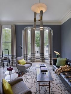 Great window treatments - love the chandelier- Sara Story Interior Design