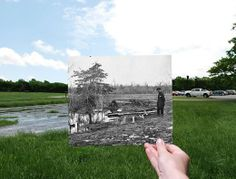 """Then and Now: Graves on Henry Hill In 1862, Wisconsin soldier Charles Dean drew a rough sketch of the First Manassas battlefield. In the drawing, he noted a """"small water hole surrounded with rebel graves"""" on Henry Hill. Whenever any significant amount of rain falls at the park, a marshy pool of water forms several feet away from the visitor center and parking lot. This photograph from March 1862 shows the wooden grave markers described by Dean along this same pool of water."""