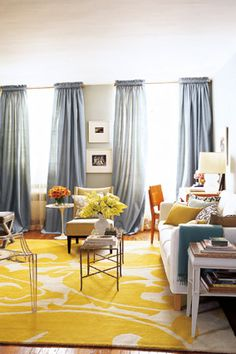 Room with yellow rug by Lance Boyd. LOVE the BRIGHT rug to spruce up a room!