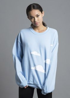 Inject some cheer into a rainy afternoon, or dress to match a bright spring morning. Light blue jersey sweatshirt, featuring soft, white, flocked clouds. Soft j