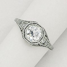 Diamond and Platinum Ring, circa 1910  Set with an old European-cut diamond weighing approximately 0.55 carat, the shoulders accented by smaller old European-cut diamonds