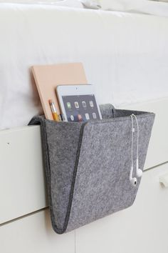 Keep your bedside area clutter free with the Bedside Pocket storage solution. Attaches to any bed or sofa for quick storage of personal items. Bedside Caddy, Bedside Organizer, Hanging Organizer, Hanging Storage, Bedside Storage, Bedside Tables, Pocket Organizer, Bedside Cabinet, Gifts For Teen Boys