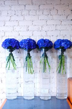These were for a corporate event today, we used stunning blue hydrangea, delphiniums and sunflowers, just arranged simply in individual vases, sometimes this looks better than a large mixed arrangement, we think it works well with these flowers. #reidsflorists #summerflowers #corporateflowers