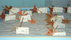 Beach wedding starfish place cards in a sandbox