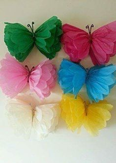 Love these tissue paper butterflies-- what a fun DIY decoration for a girl's birthday party!