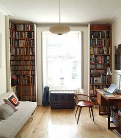 i love the light & high shelves to frame the window; i'd make a window seat or set good seating at the window however