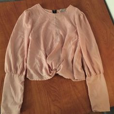 Really cute blouse Pale pink. It's a size large but I'm a true small and it looked really cute on! KATIEK Tops Blouses