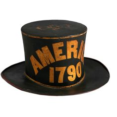"""Paint Decorated Leather Parade Hat Possibly Pennsylvania Circa 1790 With scrolled brim, in black paint, the top bears initials M., the sides bear word """"AMERICA"""" and initials """"FA"""" with a fire hydrant. Antique Items, Or Antique, Modern Decorative Objects, Don Delillo, Fire Helmet, Painting Leather, Art Furniture, Vintage Antiques, Folk Art"""