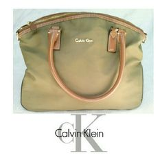 """CALVIN KLEIN OLIVE NYLON & LEATHER DOME BAG CALVIN KLEIN OLIVE COLOR NYLON & LEATHER DOME POCKETBOOK Beautiful & spacious bag ! * Inside zippered compartment  * Divided compartment on other side * Gold tone hardware * 2 stitched leather handles * Height 10"""" X  L13"""" X W 6"""" * VERY CLEAN inside except for 1 pen line (2nd pic) * SOME KIND of stain on back. Water? IDK. This was never used & stored but SOMEHOW a pen mark on inside. Other than that very clean. Price reflects condition but open to…"""