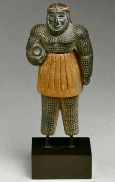 REPRESENT. Monstrous male figure, Period- Bronze Age, Date- ca. late 3rd–early 2nd millennium B.C., Geography- Bactria-Margiana or eastern Iran, Culture- Bactria-Margiana Archaeological Complex, Medium- Chlorite, calcite, gold, iron, Dimensions- H. 4 in. (10.1 cm), The Metropolitan Museum of Art