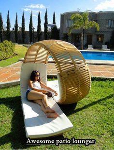 A modern outdoor tete-a-tete lounger chair.